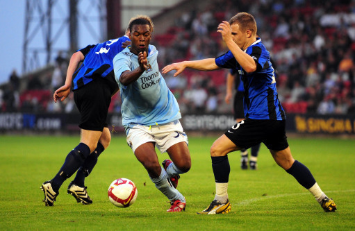 Manchester City's Daniel Sturridge takes on EB Streymur's Leif Niclasen (right) during the UEFA Cup Qualifying match at the Oakwell Stadium in Barnsley.