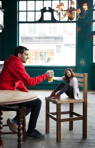 EDITORIAL USE ONLY Celebrity magician Dynamo, real name Steven Frayne, creates a series of original photographic illusions, including 'shrinking his friend to the size of a pint…