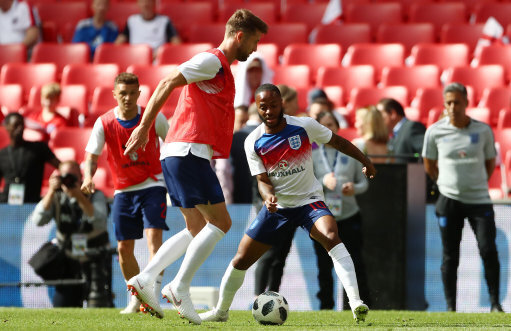 England's Gary Cahill (left) and Raheem Sterling warm up during the International Friendly match at WembleyStadium, London.