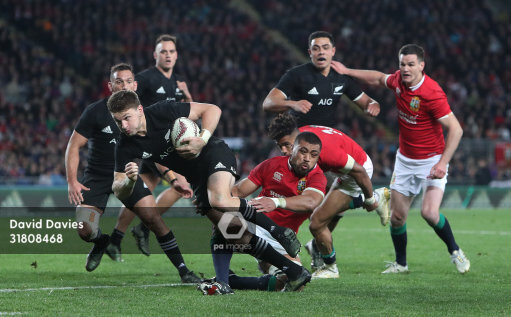 New Zealands Beauden Barrett Is Tackled By British And Irish Lions Taulupe Faletau During The