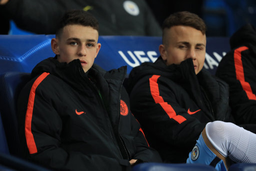 Manchester City's Phil Foden (left) on the bench during the UEFA Champions League, Group C match at the Etihad Stadium, Manchester.