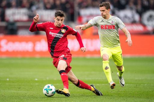 Leverkusen's Kai Havertz (l) and Cologne's Simon Zoller vie for the ball during the Bundesliga soccer match between Bayer Leverkusen and 1. FC Cologne in the BayArena in...