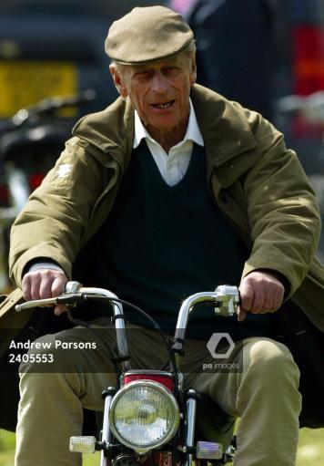 HRH The Duke Of Edinburgh On A Mini Motorbike