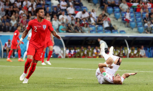 File photo dated 18-06-2018 of England's Kyle Walker (left) concedes a penalty after colliding with Tunisia's Fakhreddine Ben Youssef.