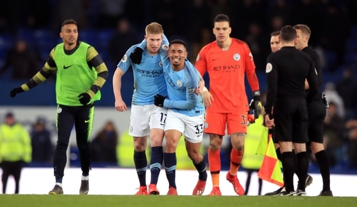 Manchester City's Gabriel Jesus (centre) and Kevin De Bruyne embrace after the Premier League match at Goodison Park, Liverpool.