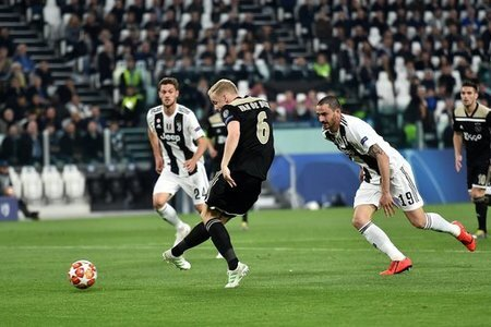 Donny van de Beek of Ajax scores goal of 1-1 during the Uefa Champions League 2018/2019 round of 8 second leg football match between Juventus FC and Ajax Amsterdam at Juventus…