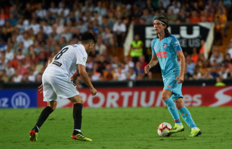 Carlos Soler of Valencia CF and Filipe Luis of Atletico de Madrid during the La Liga match between Valencia CF and Atletico de Madrid at Mestalla Stadium on August 20, 2018 in…