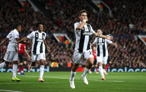 Juventus' Paulo Dybala celebrates scoring his side's first goal of the game during the UEFA Champions League match at Old Trafford, Manchester.