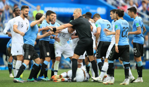 Tempers flare between players as France's Kylian Mbappe lies on the ground
