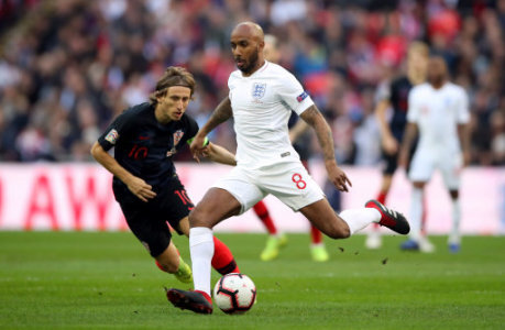 England's Fabian Delph is put under pressure by Croatia's Luka Modric