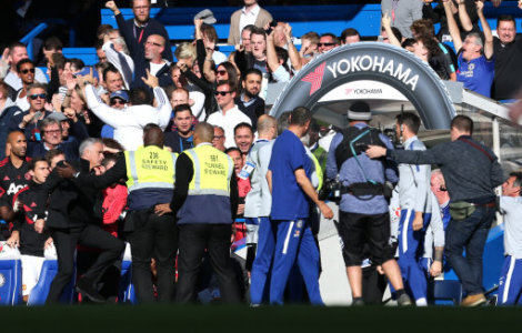 Tempers flare as Manchester United manager Jose Mourinho (left) runs towards a Chelsea's Second Assistant Coach Marco Ianni (not in frame) as he celebrates Chelsea's Ross Barkley…