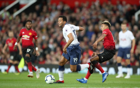 Tottenham Hotspur's Mousa Dembele (centre) and Manchester United's Jesse Lingard battle for the ball during the Premier League match at Old Trafford, Manchester.