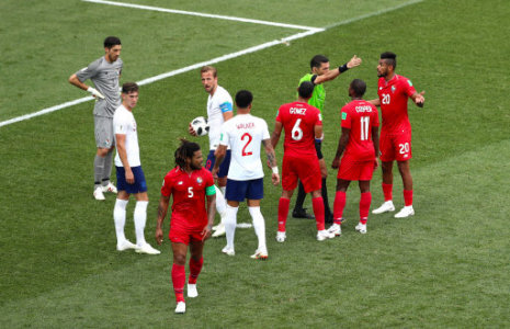 England's Harry Kane steps up to take his second penalty as Panama players speak with referee Gehad Grisha during the FIFA World Cup Group G match at the Nizhny Novgorod Stadium.