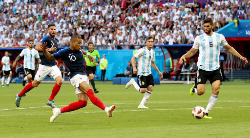 France's Kylian Mbappe scores his side's fourth goal of the game