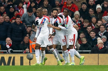 Crystal Palace's Andros Townsend (left) celebrates scoring his side's first goal of the game with team-mate Wilfried Zaha during the Premier League match at Anfield, Liverpool.