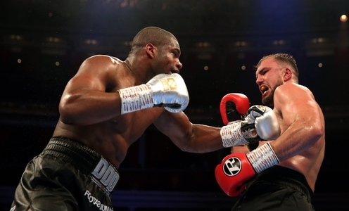 Daniel Dubois (left) and Razvan Cojanu during the Vacant WBO European Championship bout at the Royal Albert Hall, London.