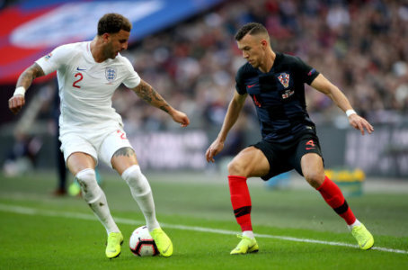 Croatia's Ivan Perisic (right) and England's Kyle Walker (left) battle for the ball during the UEFA Nations League, Group A4 match at Wembley Stadium, London.