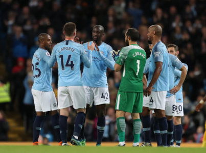 Yaya Toure of Manchester City is surrounded by players as he is substituted during the premier league match at the Etihad Stadium, Manchester. Picture date 9th May 2018. Picture…