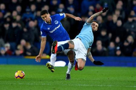 Manchester City's Nicolas Otamendi andEverton's Dominic Calvert-Lewin battle for the ball