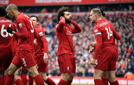 Liverpool's Mohamed Salah (centre) celebrates scoring his side's second goal of the game with team-mates during the Premier League match at Anfield, Liverpool.