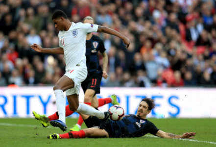 Croatia's Sime Vrsaljko (left) slides in on England's Marcus Rashford (right) during the UEFA Nations League, Group A4 match at Wembley Stadium, London.