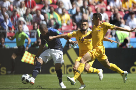 (180616) -- KAZAN, June 16, 2018 (Xinhua) -- Kylian Mbappe of France (L) shoots during a group C match between France and Australia at the 2018 FIFA World Cup in Kazan, Russia,…