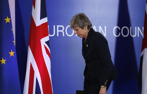 British Prime Minister Theresa May leaves after addressing a media conference at an EU summit in Brussels, Friday, March 22, 2019. Worn down by three years of indecision in…
