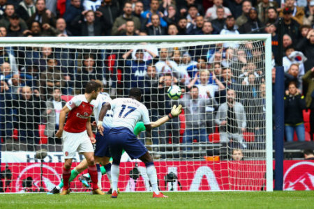 Moussa Sissoko of Tottenham Hotspur sees his shot saved by Bernd Leno of Arsenal during the Premier League match at Wembley Stadium, London. Picture date: 2nd March 2019. Picture…