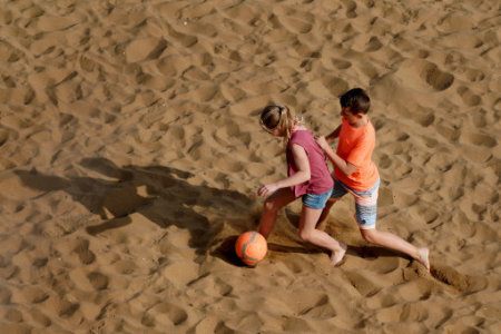 Children enjoy the sunshine on the beach in Broadstairs, Kent, as Hurricane Ophelia hits the UK and Ireland with gusts of up to 80mph.
