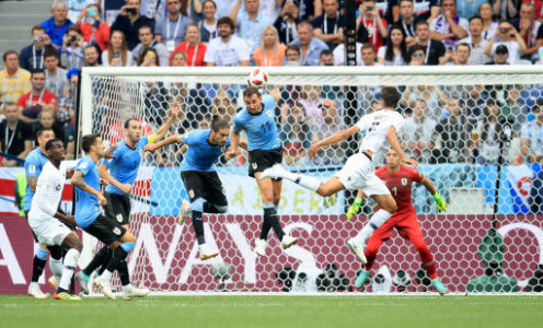 France's Raphael Varane (right) scores his side's first goal of the game