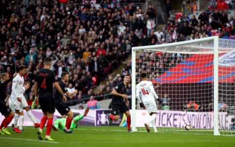 England's Jesse Lingard scores his side's first goal of the game